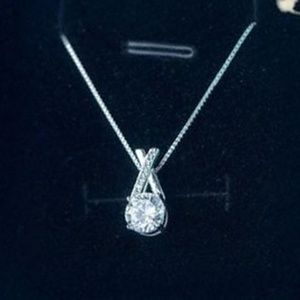 Jewelry - Sterling Silver Kiss and a Hug CZ Pendant Necklace